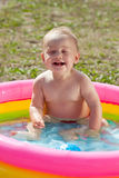 Happy baby swimming  in kid  pool Royalty Free Stock Photos