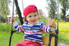 Happy baby on swing Stock Photo