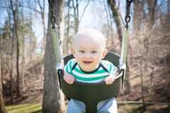 Happy Baby Swinging Stock Images