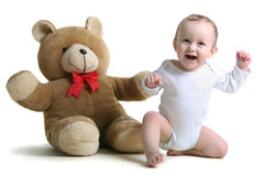 happy baby with teddy bear