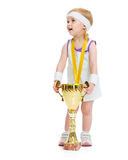 Happy baby in tennis clothes with medal and goblet Stock Photography