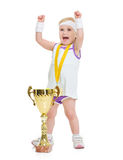 Happy baby in tennis clothes rejoicing success Stock Photos
