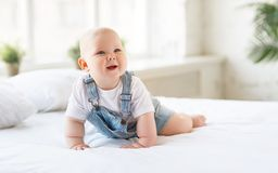 Happy baby toddler in bed Royalty Free Stock Photos