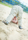 Happy baby toddler standing upside down Royalty Free Stock Photo