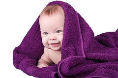 Happy baby with towel Stock Photo