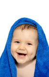 Happy baby in a towel Stock Photo