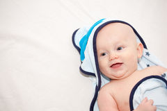 Happy Baby in Towel After Bath Royalty Free Stock Images