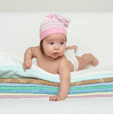 Happy baby on towel Stock Images