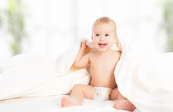 Happy baby under a blanket laughing Stock Photos
