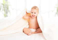 Happy baby under a blanket laughing Royalty Free Stock Images