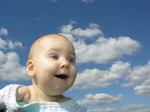 Happy baby under clouds royalty free stock photo