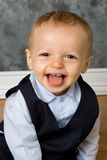 Happy Baby. Very Happy smiling baby boy in suit sticking out his tongue Royalty Free Stock Photos