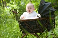 Happy baby in vintage pram Royalty Free Stock Photo