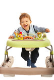 Happy baby in walker Stock Images