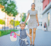 Happy baby walking with mom in city Royalty Free Stock Image