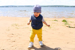 Happy baby walking on riverside Royalty Free Stock Images