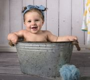 Happy baby in wash tub royalty free stock images