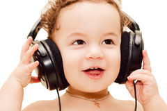Happy baby wearing big black headphones Stock Image