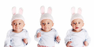 Happy baby wearing bunny cap Stock Image