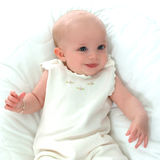 Happy Baby in White. Smiling baby girl in white on white background Royalty Free Stock Photos
