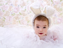 Baby in white rabbit costume Stock Images