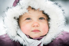 Happy baby on the winter background Stock Photography