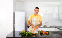 Happy bachelor cooking Royalty Free Stock Photos