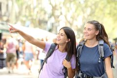 Happy backpacker friends sightseeing royalty free stock photo