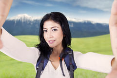 Happy backpacker taking selfie picture at mountain Royalty Free Stock Photos