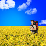 Happy backpackers in flowers field Stock Photos