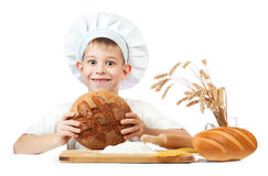 Happy baker boy with a loaf of rye bread Stock Photos