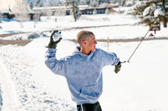 Bald boy throwing snowball Stock Image