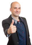 Happy bald businessman shows thumbs up Stock Photos