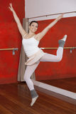Happy Ballerina Performing In Dance Studio royalty free stock photography