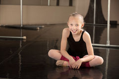 Happy Ballerina Sitting on Floor Stock Photos
