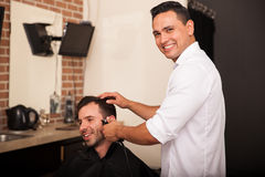 Happy barber enjoying work Stock Photo