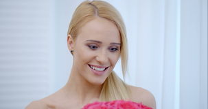 Happy Bare Woman Looking at Pink Flowers stock footage