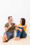 Happy barefoot young couple celebrating Royalty Free Stock Photography