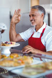 Happy barista gesturing ok sign behind counter Royalty Free Stock Photo