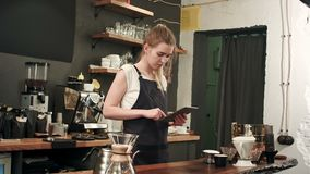 Happy barista or waiter in apron with tablet pc computer at bar or coffee shop. Professional shot in 4K resolution. 089. You can use it e.g. in your commercial stock video