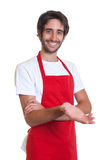 Happy barkeeper inviting his guests Royalty Free Stock Photography
