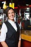 Happy barmaid smiling at camera Royalty Free Stock Photo