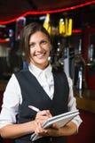 Happy barmaid smiling at camera taking notes Stock Photos