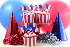 Happy Bastille Day cupcakes. Happy Bastille Day cupcakes in bright red, white and blue party setting Stock Images