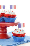 Happy Bastille Day Party Cupcakes. Red, white and blue theme cupcakes on white wood table for Bastille Day or French party celebration Stock Photo