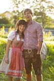 Happy bavarian couple in the evening sun Royalty Free Stock Images