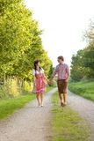 Happy bavarian couple in the evening sun Stock Images