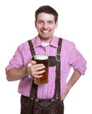 Happy bavarian guy with leather pants and a glass of beer Stock Photos