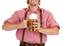 Happy Bavarian man  holds Oktoberfest beer stein Royalty Free Stock Image