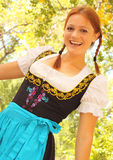 Happy Bavarian Woman Among Autumn Leaves Royalty Free Stock Photo